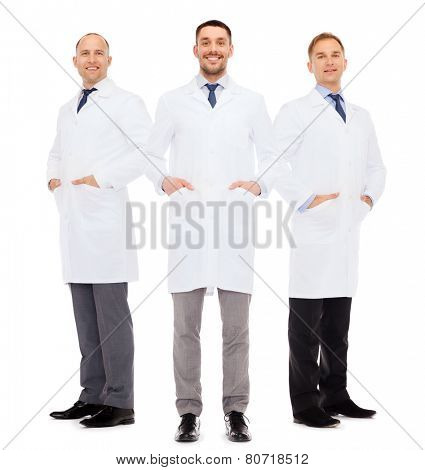 healthcare, profession and medicine concept - smiling male doctors in white coats over white background poster