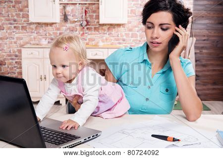 business woman working her baby girl