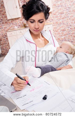 Young mother working with her baby
