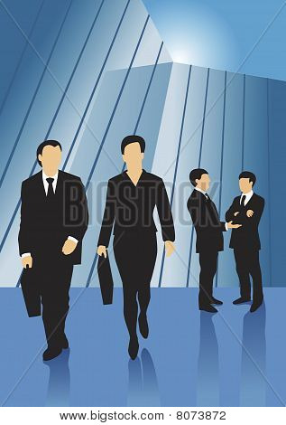 Business people in front of glass building