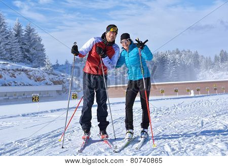 A man and a girl relaxing after training at Cheile Gradistei Biathlon Arena - Cross country skiing
