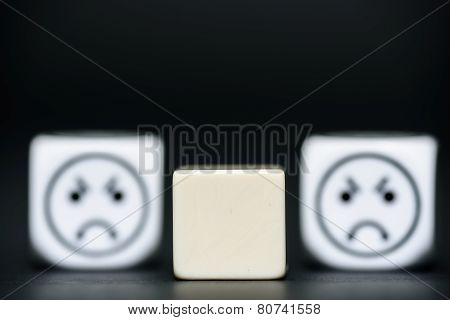 Blank Dice With Emoticon Dice (angry)in Background