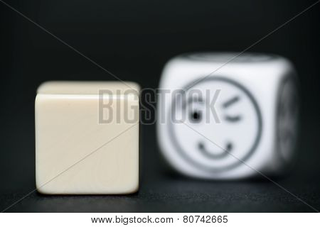 Blank Dice With Emoticon Dice (happy, Blinking) In Background