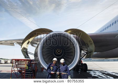 airplane mechanics and giant jet engine repair