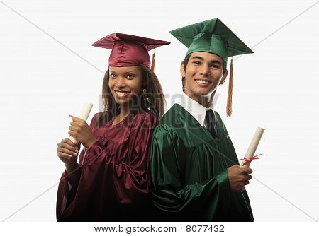 multi race couple in cap and gown