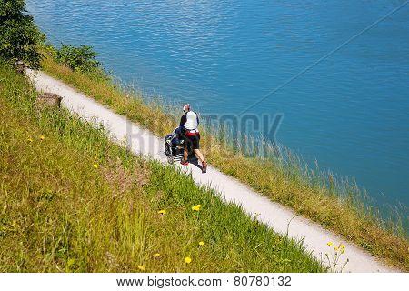 Dad Running And Pushing Stroller
