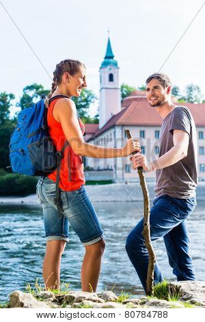 Tourist couple hiking at Danube Weltenburg monastery poster