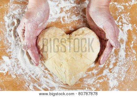 Woman Holding Dough Heart