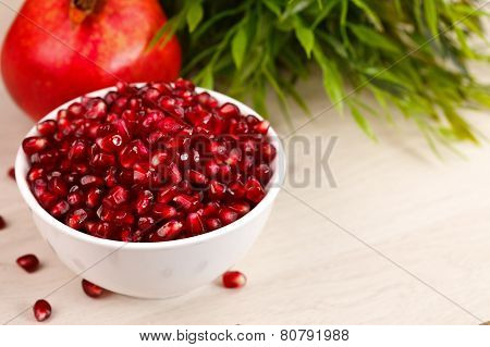 Grenadine Seeds With Fruit And Leaves