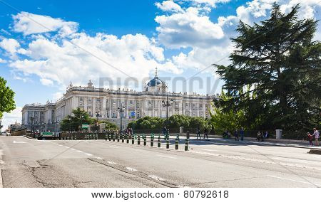 Royal Palace With Tourists On Spring Day In Madrid