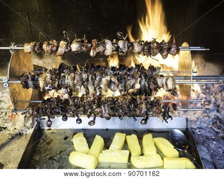 Birds Turning On A Spit And Cook Slowly To The Heat Of The Flame