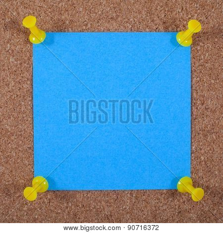 Blank Note Paper Pinned To A Noticeboard