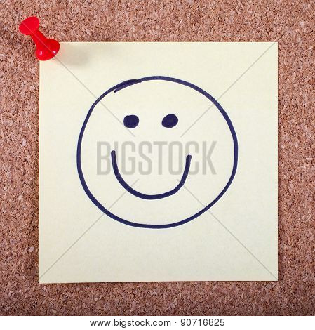 Happy Face Pinned To A Noticeboard