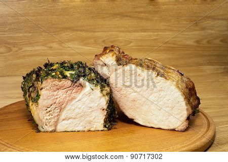 Two Various Pieces Of Baked Meat On A Round Board2.