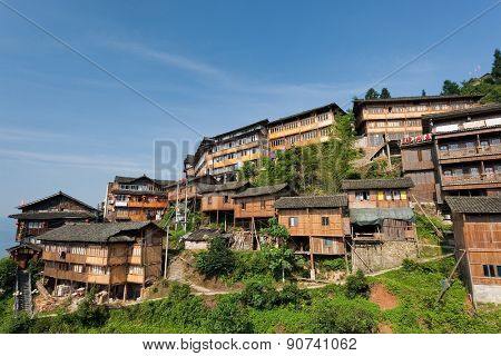 MAY 25, 2010 - GUANGXI, CHINA: Traditional multi-storey wooden buildings fill the hill slopes of Longshan in Guangxi province. Many of the buildings are converted to hotels to cater to tourists.