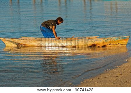 JUNE 28, 2008 - SABAH, MALAYSIA: An unidentified sea gypsy man takes a boat out to sea from his village on Mabul Island, Sabah, Malaysia.