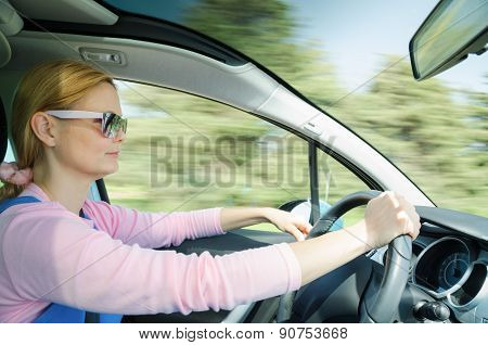 Pretty Woman In Sunglasses Driving Fast Car