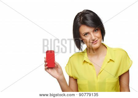 Confident woman showing blank credit card