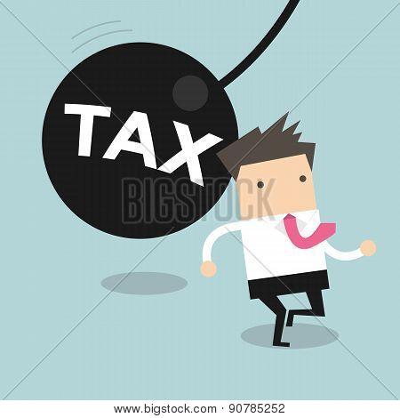 Businessman running away from huge pendulum with message 'tax'
