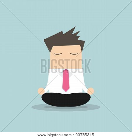Businessman yoga relaxing during hard workday