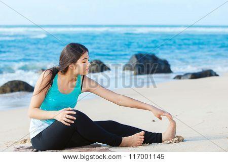 Teen Girl Exercising On Sandy Beach Of Hawaii Near Ocean