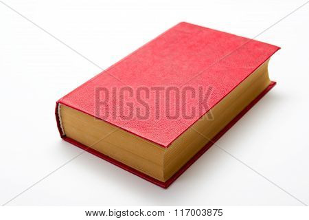 Blank red hardcover book on white background with copy space