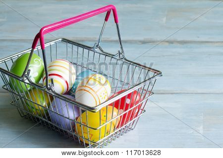 Easter eggs in a shopping basket commercial concept