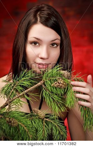 Beautiful Girl With Pine Branch