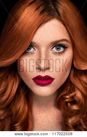 Beauty Portrait Of A Redhead Girl With Freckles