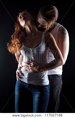 Sexual woman with red hair and hugging man