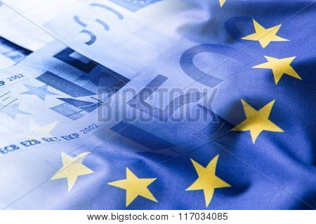 Euro flag. Euro money. Euro currency. Colorful waving european union flag on a euro money background