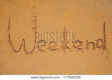 Weekend Sign Writen On Beach Sand