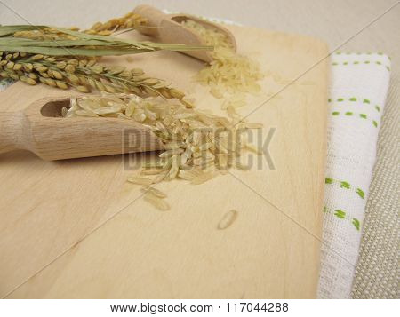 Brown and white rice and rice panicles