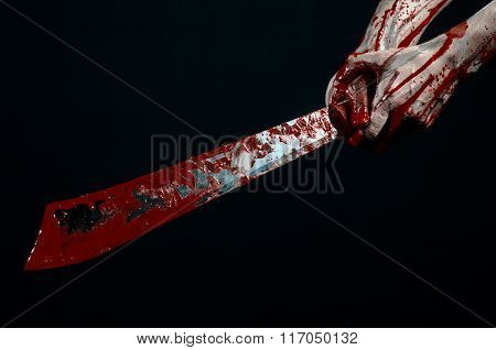 Bloody Halloween Theme: Bloody Hands Holding A Bloody Machete Isolated On Black Background In Studio