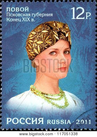 RUSSIA - CIRCA  2011: stamp printed in Russia, shows a woman in a female headdress of  Russian North