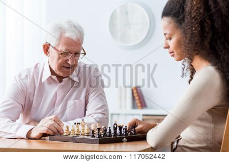 Retired Man Playing Chess