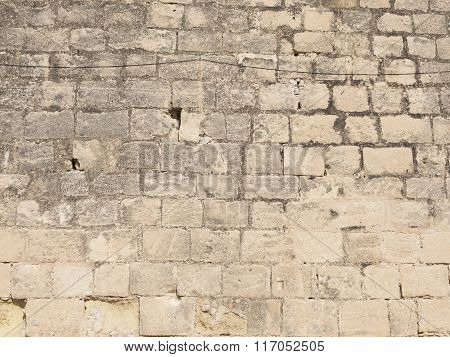 Very Old Wall Of Stone Blocks