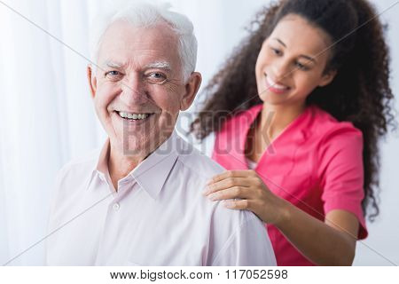 Happy Senior And Caregiver