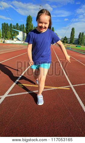 Little Girl Have Fun On The Stadium
