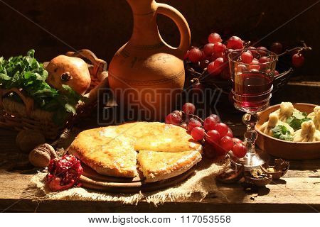 Wine, Grapes And Pie With A Cheese Stuffing