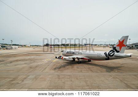 SINGAPORE - NOVEMBER 04, 2015: Jetstar aircraft in Singapore Changi Airport. Jetstar Airways Pty Ltd, trading as Jetstar, is an Australian low-cost airline headquartered in Melbourne, Australia.