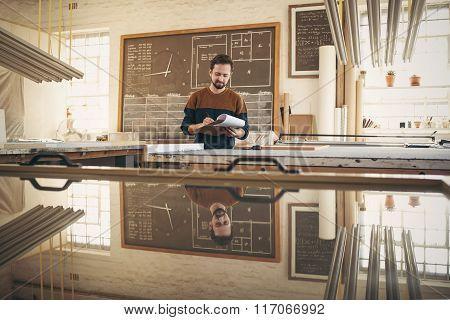 Designer checking stock in his studio workshop
