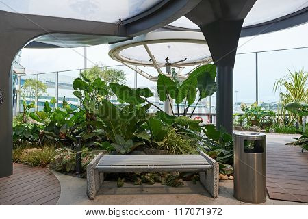SINGAPORE - NOVEMBER 04, 2015: smoking area at Singapore Airport. Singapore Changi Airport, is the primary civilian airport for Singapore, and one of the largest transportation hubs in Southeast Asia