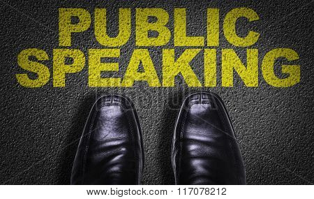 Top View of Business Shoes on the floor with the text: Public Speaking