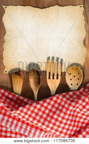 Kitchen Utensils On Wooden Table With Tablecloth