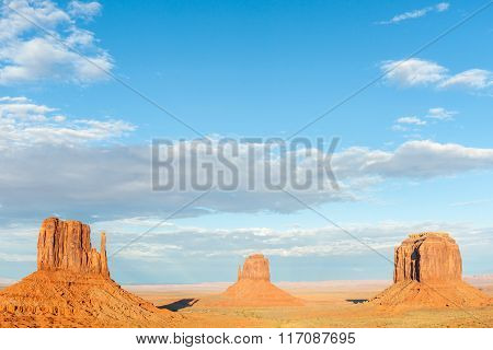 Three Buttes In Monument Valley Dramatic Scenery.
