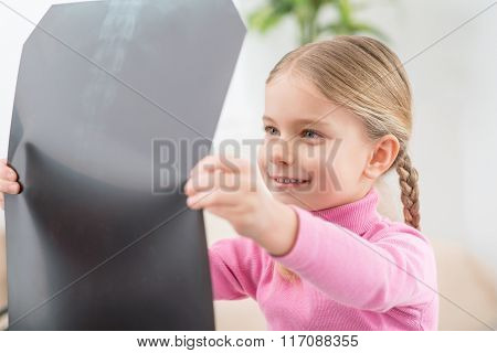 Little girl holding her radiogram