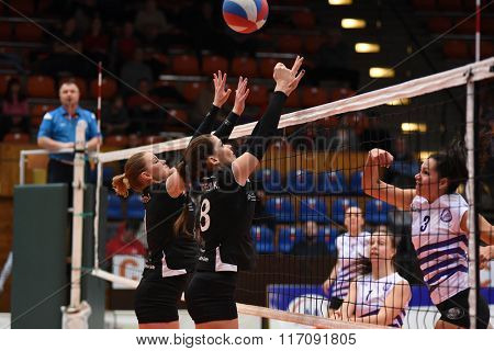 KAPOSVAR, HUNGARY - JANUARY 17: Kitti Szombathelyi (black 8) in action at the Hungarian I. League volleyball game Kaposvar (black) vs Ujpest (white), January 17, 2016 in Kaposvar, Hungary.
