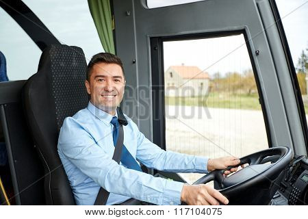 happy driver driving intercity bus