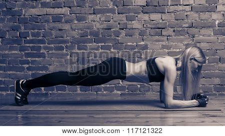 Fitness, Sport, Training And Lifestyle Concept - Woman Doing Plank Exercises On Mat At The Gym.
